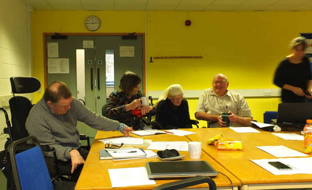 Forum Trustees sat round a table at a meeting
