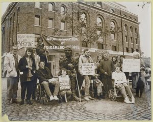 A photo of Disabled people demonstrating about the lack of access, outside the Arnolfini