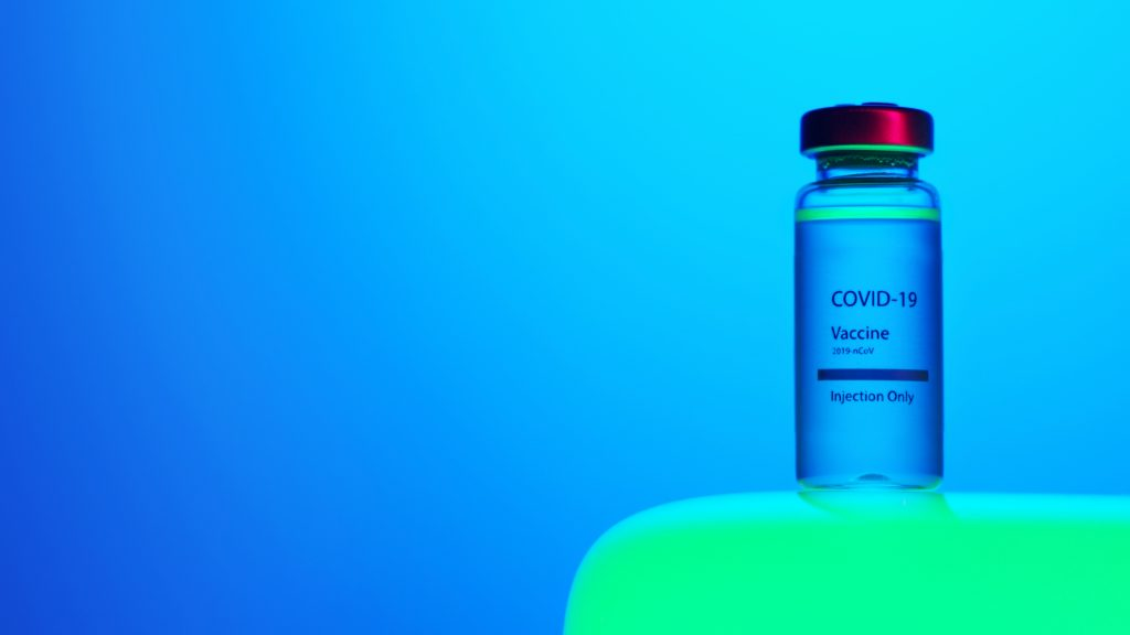 Image of a small bottle of a COVID vaccine with the label saying COVID-19 Vaccine Injection Only.