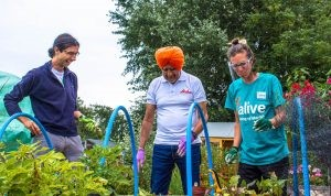 Photograph of three people gardening taken from the Bristol Food Network website.